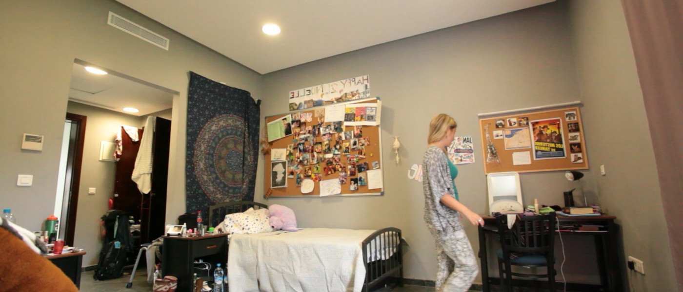 A student prepares for class in her modern dorm room within the U N E Tangier residences