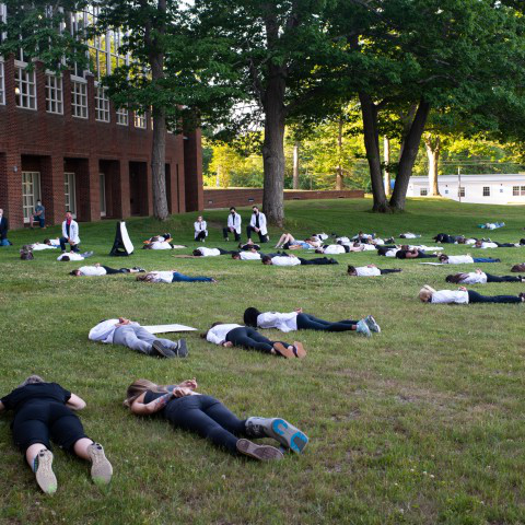 关于 70 UNE community members lay face down or kneel in protest of police brutality and systemic racism on June 12.